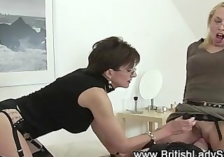 pair of ladies and a whip receive dominating